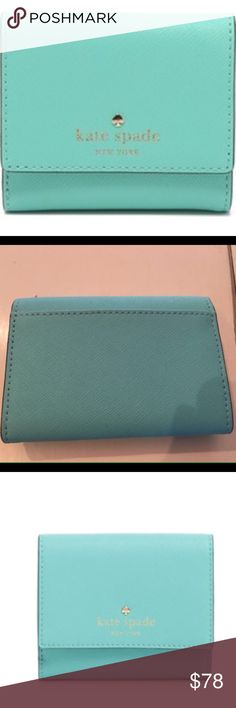 """NWT -Kate Spade Cedar Fresh Air Tri-Fold Wallet Polished and petite in scratch-resistant robin's egg blue saffiano leather, kate spade new york's snap-front wallet is sized to fit within in almost any carryall. Saffiano leather; trim: polyurethane; lining: faille Imported Snap closure; lined Two interior slip pockets, bill slot, six card slots, interior slip compartment 4""""L x 3.5""""H retail $128.00 sold out everywhere- my last one! kate spade Bags Wallets"""