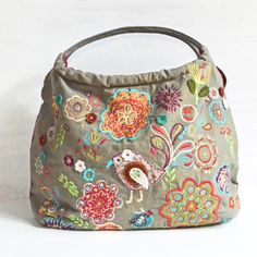 Features an embroidered bird - Embroidered Bag, handcrafted and fair trade from India