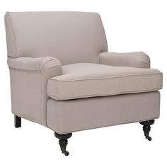 A timeless addition to your living room or den, this stylish arm chair showcases classic linen upholstery and castered front feet.   Product: Arm chairCon...