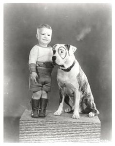 Spanky and the Pitbull, Petey, from The Little Rascals series.