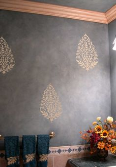 .I love everything about this wall, the cloudy, moody gray, the fleshy crown and the metallic medallions. Really would be best on a wall that will not have any other artwork, or use a smaller scale for rooms that will hang larger paintings on.