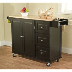 @Overstock.com - Black/ Natural Aspen 3-drawer Kitchen Cart - If you like to have your kitchen implements handy this black wooden kitchen cart would suit your needs. Featuring storage shelves, three drawers, a towel rail, and a spice rack, this wheeled cart with drop-leaf top can be placed wherever you need it.  http://www.overstock.com/Home-Garden/Black-Natural-Aspen-3-drawer-Kitchen-Cart/7217907/product.html?CID=214117 $319.99