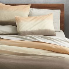 desert life.  Orange, pale yellow and taupe gradient make the bed in comforting earthy hues.  In an elaborate ombre-creating process, cotton/linen fabric is dyed, then cut to size, and dyed again—-this time using a special technique to create the colorful gradient.  Shams and duvet are stitched together using hand-guided machines with careful attention to quality and detail.  Duvet has non-slip corner ties and hidden button closure.