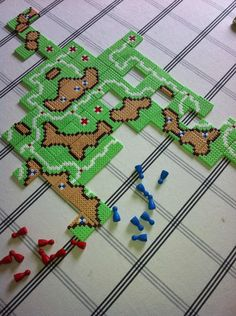 Carcassone game pieces made out of bead sprites. I think I have to do this! Found on Reddit: http://www.reddit.com/r/boardgames/comments/ygwzs/i_made_carcassonne_out_of_bead_sprites_any_tips/