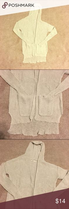 Hollister off-white cardigan Off white knitted hooded cardigan from Hollister.  Pockets on the front.  Back is slightly longer than front.  Barely worn!  Size extra small/small. Hollister Sweaters Cardigans
