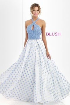 Set the trend in this darling halter gown that features a keyhole accented bodice encrusted with acrylic stones and pearls, crystal beaded waist, and a full polka dot printed skirt.