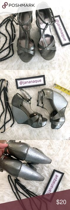 Gunmetal and Silver Wedge Sandals by Cathy Jean Gunmetal and Silver Wedge Sandals by Cathy Jean. Double strap on ankle and t-strap style on the front. Wedge platform makes it comfy to walk. Cathy Jean Shoes Wedges