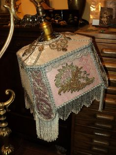 Antique French Marble Tole Bridge Lamp with Antique Metallic lace Beaded Lampshade. $2,600.00, via Etsy.