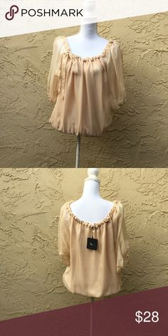 "✨✨New Beige Chiffon Evening Blouse By Ryu✨✨ Evening Blouse By Ryu For Anthropologie. Stunning Tie Neck Gathered . Attached Sleeveless Under Piece Not Removable. Sheer Overlay. Elastic hem. 3/4 Sheer Sleeves. Small Measure; 17"" armpit to armpit. Bust Size 32"" to 34"", Length 19"". Anthropologie Tops"