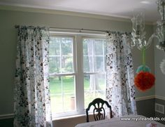 Simple curtains for the living room out of twin sheets.