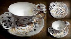 Porcelana zdobiona ręcznie rzeźbionymi ornametami i recznie malowana Porcelain decorated with sculptured porcelain ornaments and hand-painted