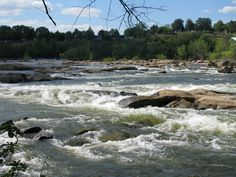 Belle Isle in Richmond, VA. This is a view of Hollywood Rapids. The other side of Belle Isle has calmer water, lots of rocks to sunbathe on. The island itself has a lot of great trails for jogging and mountain biking as well as a quarry pond and a granite wall for rock climbing.