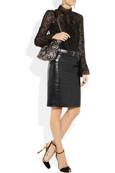 Black leather Attached designer-stamped belt, slant pockets, fully lined Concealed hook and zip fastening at back 100% leather; lining: 57% viscose, 43% polyester Specialist clean