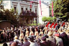 NSDAP members march down an avenue during an official Party parade.