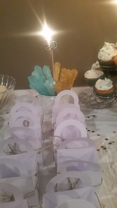 treat boxes came from the dollar tree, added twine bows for the cute factor & they were amazing little party favors at the end of the night!