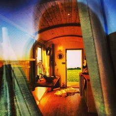 Photo by scamperholidays • Instagram Through the window of one of our sunny little Shepherd Huts on site today.