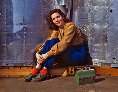 """October 1942. """"Noontime rest for an assembly worker at the Long Beach, Calif., plant of Douglas Aircraft Company. Nacelle parts for a heavy bomber form the background."""" 4×5 Kodachrome transparency by Alfred Palmer. #WWII homefront"""