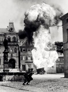Two soldiers of the Infantry Regiment dash past an explosion. Kronach, Oberfranken, Bavaria, Germany, Photo by W. World History, World War Ii, London History, Old Photos, Vintage Photos, American History, British History, Native American, Military History