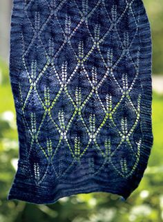 Candleflame Shawl Pattern  Free pattern from Knit Picks.  I want to do this in oranges/reds