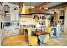 beautiful french country kitchen, large island, beamed ceiling