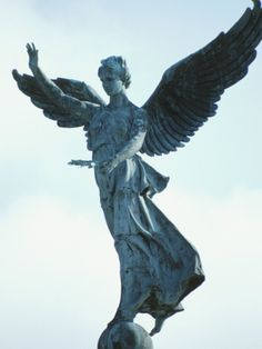 size: Photographic Print: Statue of a Cement Angel Standing on a Ball in Montreal, Quebec, Canada : Monuments, Statue Ange, Cemetery Angels, Angels In Heaven, Heavenly Angels, I Believe In Angels, Garden Illustration, Angel Statues, Angels Among Us