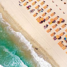 """Fine-art photographer Gray Malin was soaring over the beaches of Saint-Tropez in a helicopter when he was struck by the pattern of orange umbrellas in contrast with """"the stunning teal of the Mediterranean Sea."""" He shot the scene using a Canon 5D with a 24-105mm USM lens, no filter."""