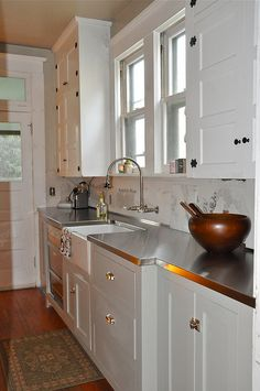 stainless counters with shaker style cabinets