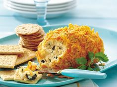 Pepper Jack Cheese Ball - Spice up the appetizer table with this south-of-the-border take on a cheese ball. Pepper Jack cheese turns up the heat, cilantro and lime add fresh zest and a crushed tortilla-chip coating adds crunch.