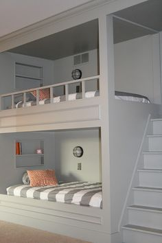 Not pining because its pretty in that battleship gray-yikes- but I do like the design for a cottage that can accommodate grown-up guests in bunks. The stairs are great!