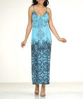 """Easy breezy style is a cinch in this bright maxi dress. A slight v-neck creates a sassy look up top while the empire waist silhouette adds a casual, flowing look.Measurements (size S): 30"""" chest (measured 1"""" below arm); 53"""" long from high point of shoulder to hem100% polyesterHand wash"""