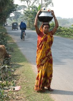 Alluring as this image may be, what it truly portrays is the economic, physical and health burden that women and girls must endure everyday of their lives to provide water for their families - this is the forgotten glass ceiling.