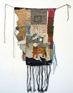 """The Spirit of the small Journeya hand stitched story cloth. 12"""" x 18"""" more or less plus fringe.The story of wandering and the quest for a sense of place. It is about NoWhere and then again SomeWhere.Layers of cotton linen silk, hand dyed and vintage scrap. No batting. Removable string ties.Signed on the boro style back.10% discount if you pay by check. ($225.00)"""