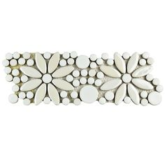 This porcelain border tile takes the classic penny round tile and matches it with a decorative flower pattern, making an eye-catching combination of shapes and sizes. It pairs beautifully with penny round tile as a border. One of The Home Depot's most-pinned products.