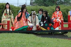 Women dressed in junihitoe for a ceremony.