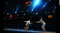 Paris A. Inostroza Budinich of Chile competes against Max Heinzer of Switzerland in the men's individual epee fencing round of 32 on Wednesd...