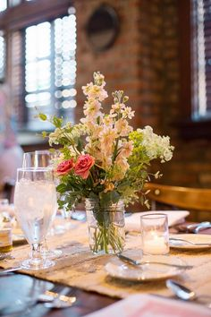 a simple wedding centerpiece | Photography by Betty Elaine | http://www.mywedding.com/articles/thomas-and-torreys-sweet-st-louis-wedding-by-photography-by-betty-elaine/