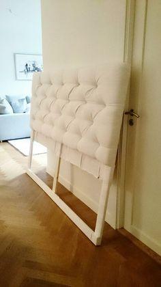 stoppad sänggavel med knappar