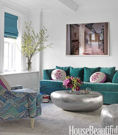 Teal is the hot new color, forget the earth tones! Love the Silver coffee table, and swirly retro pattern on side chair..