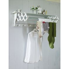 The perfect solution when space is tight, this versatile dove grey wooden dryer has seven useful rails, six wooden hooks beneath and a handy top shelf.  Made from painted birch plywood, with zinc rails. Includes fixings for wall hanging.