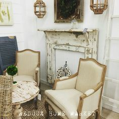 Occasional chairs,  chippy old mantle, lanterns complete that Farmhouse look