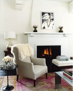 love the persian rug and bright white walls with dark wood floors