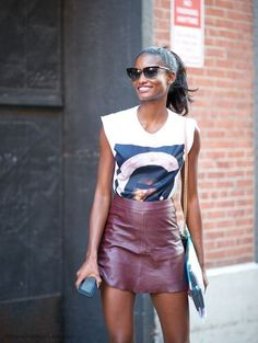 Brown faux leather A-line miniskirt worn with white graphic tee with cutoff sleeve.. DIY the look yourself: http://mjtrends.com/pins.php?name=brown-vegan-leather-fabric-for-skirt