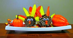thanksgiving centerpiece for the babyhead and i to do...dollar store for anything ill need and pinecones can be found at the park