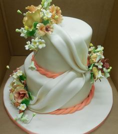 Calumet Bakery Wedding cake with fondant swag and coral rope border.
