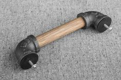 Each drawer pull is hand crafted from black iron pipe fittings and oak wood. The wood is unfinished, giving you the option to leave it as is or stain