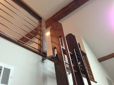 Our pivoting loft ladder adds an extra layer of safety by holding the ladder in place with a metal bracket that is affixed to your wall.  When not in use, it can easily be moved to an upright position to save space.  Our pivoting ladder can be crafted from any of our reclaimed or old growth woods.  Several hardware choices are also available