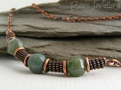 Using coiled wire and jump rings between beads. Antiqued copper necklace with Indian Fancy Jasper and spiral coils of copper.