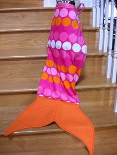 Make mermaid towel tails SO FUN!!!  Ribbon tie at one end of towel, fleese fins at the other end.