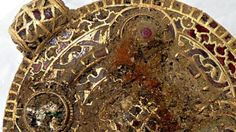 """A student unearths an """"outstanding"""" piece of Anglo-Saxon jewellery experts believe could be worth tens of thousands of pounds."""
