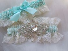 Wedding garter set Tiffany blue satin and ivory Chantilly beaded lace with crystals beaded applique. $50.00, via Etsy.